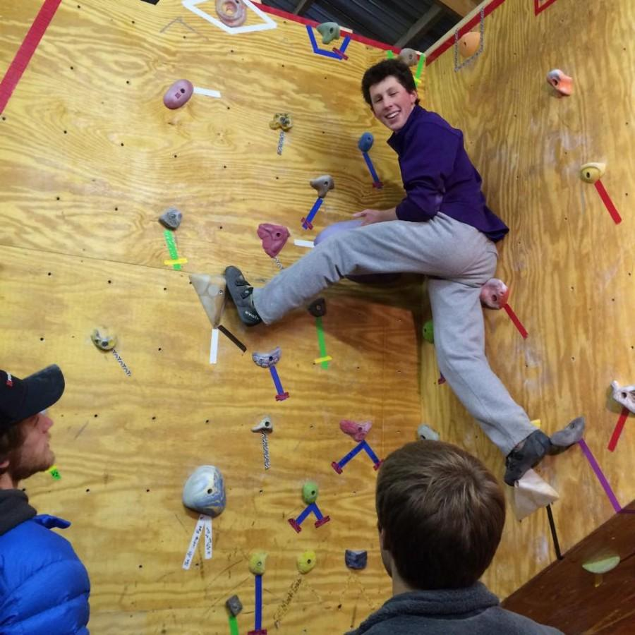 Local high school student Ryan Frasier outclimbed the collegiate competition at this weekend's bouldering competition. Photo by Outing Club staff.