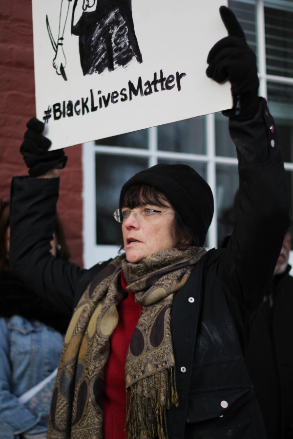 A member of the crowd holds poster with what has become a nationwide slogan: #blacklivesmatter.