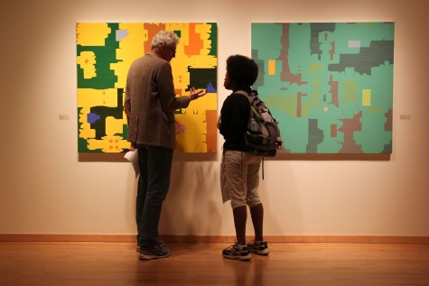 Paul Ryan, left, talks with Anthonia Adams about his work hanging in the Staniar Gallery. Photo by Ellen Kanzinger, '18