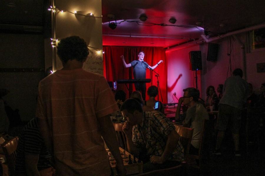 Students listen as Elliot Reza performs at Friday Underground.