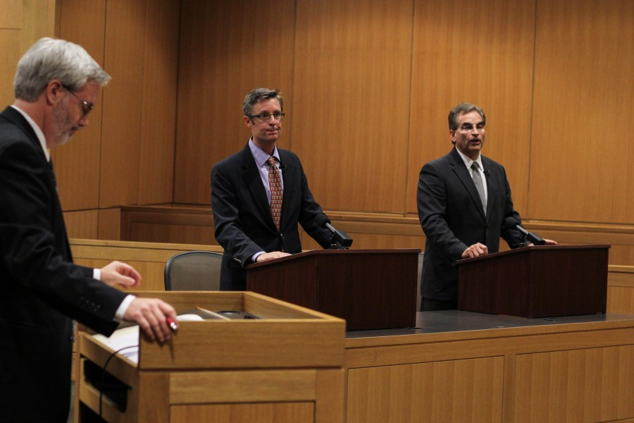 Josh Elrod, middle, and Chris Billias, right, answer questions at the commonwealth's attorney's debate on Wednesday at the Law School.