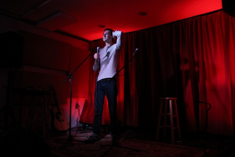 Henry Luzzatto, the winner of the night's competition, performs stand up at Friday Underground. Photo by Ellen Kanzinger, '18.