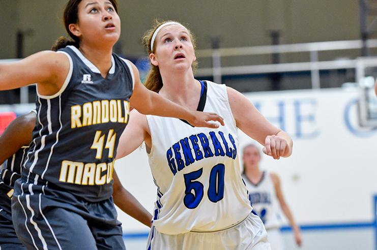 Emma Redding, '18, fights for a rebound against Randolph-Macon. She is bringing down 5.4 rebounds per game. Photo courtesy of W&L Sports Info.