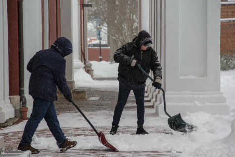 shoveling snow on the colonnade