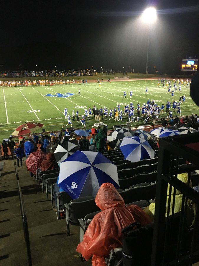 Umbrellas abounded in the stadium, as fans endured a downpour to see a Generals victory. Photo by Kathryn Young, 19.