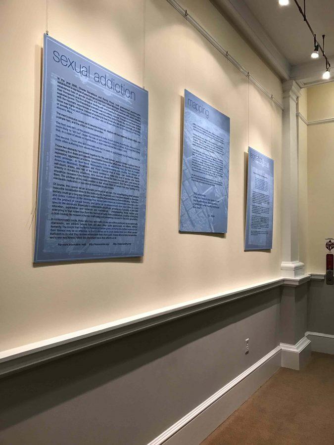"Sandberg's exhibit, ""Stories in Blue,"" in Holekamp Hall. Photo by Alexandra Cline, '19."