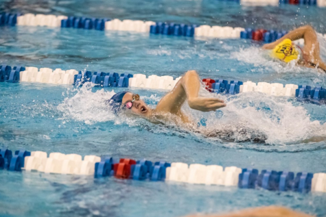 Ali MacQueen, '20, takes a breath as she races to beat her competition. Photo courtesy of W&L Sports Info.
