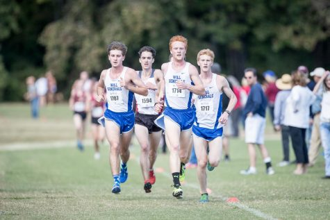 MacKenzye Leroy, '18, competing with teammates close during cross country season. Photo courtesy of W&L Sports Info