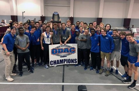 Men's track celebrates its second-straight ODAC trophy. Photo courtesy of W&L Sports Info