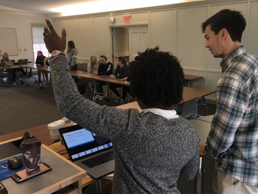 Peer Counselors Joelle Simeu, '20, and Christopher Watts, '21, lead a wellness check-in exercise. Photo by Laura Calhoun, '20.