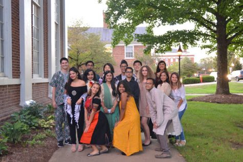 Participants in the Multicultural Fashion Show pose outside of Evans Dining Hall on Sept. 29. Photo courtesy of Riwaj Shrestha, '22.