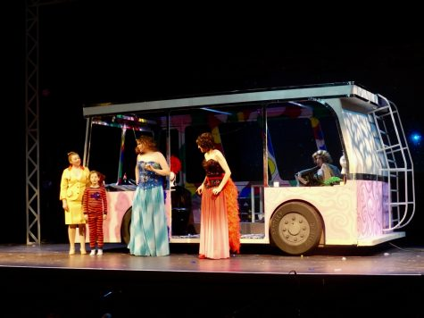 The main characters and Priscilla, their bus. Photo by Claudia Schwab.