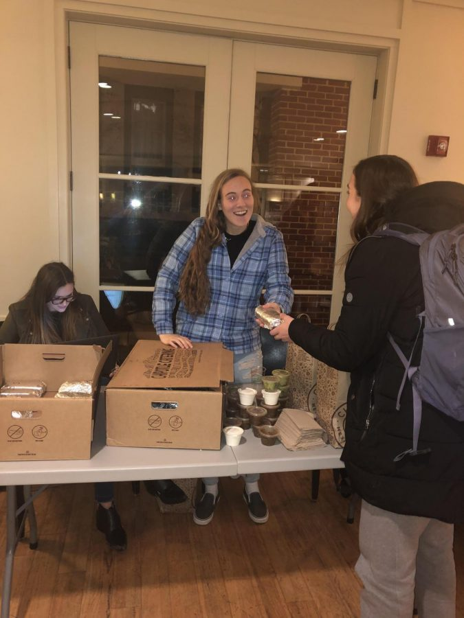 Leeann Passaro, '20, is the LGBTQ+ editor for Diverge. Above, she hands out Chipotle burritos during one of the club's fundraising events. Photo by Jordan Diehl, '22.