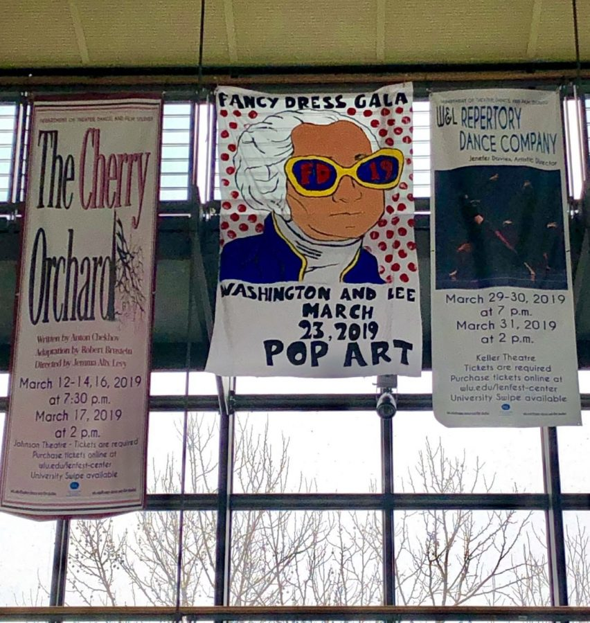 A+banner+advertising+Fancy+Dress+hangs+in+the+Elrod+Commons+atrium.+Photo+by+Liza+Moore%2C+%2721.