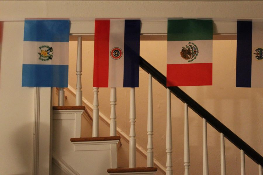 The living room of the Nuestro Hogar Latino displays flags of various Latin American countries. Photo by Jin Ni, '22.