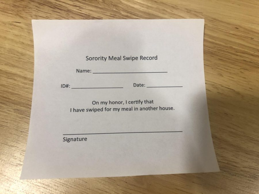 Dining Services temporarily required students to sign these slips when they swiped for meals in the sorority houses. Photo by Elizabeth Bell.
