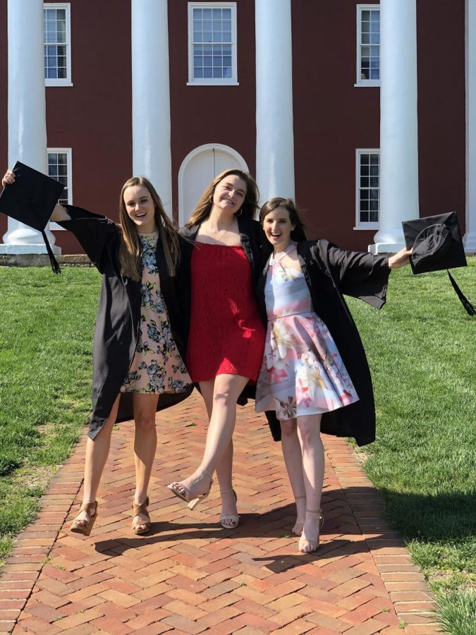 From left to right: Elizabeth Thompson, '20, Kathryn Gerbo, '20, and Elizabeth Underwood, '20 pose for early graduation photos on the Colonnade. Photo courtesy of Elizabeth Underwood.