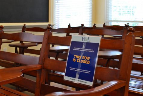 Signs block off chairs in the classrooms of Chavis Hall to facilitate social distancing.
