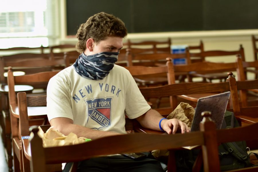 Students are required to  stay six feet apart and wear face coverings during indoor, in-person classes.