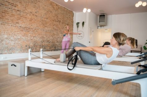 Pilates students use a reformer, an appara-tus with tension pulleys meant to challenge the body. Photo courtesy of Kevin Remington.