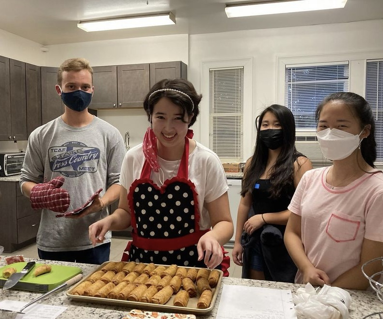 Aislinn Niimi, 24, prepares egg rolls. Photo by Angela Tu, 24.
