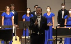 Dr. Shane Lynch addresses the audience at the choral performance from University Singers, Glee Club and Cantatrici on Oct. 1. Screenshot from livestream provided by Catherine McKean, '24.